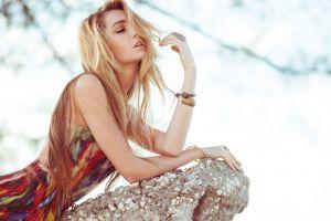 blonde dress rock model women bracelets long hair colorful closed eyes hair in face kristina hoock lying on front sensual gaze
