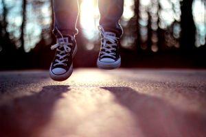 bokeh legs shoes sunlight jumping