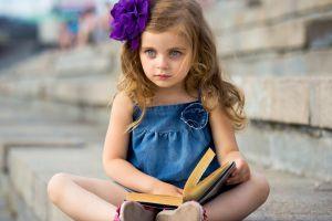 books brunette sitting blue eyes flower in hair children