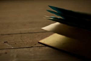 books wooden surface depth of field shadow