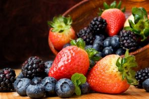 bowls strawberries blackberries blueberries