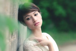 brunette thinking short hair women soft model face eyeliner brown eyes looking away white tops asian pierced nose