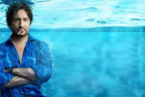 californication humor underwater blue hank moody relaxing david duchovny smoking bracelets smiling blue shirt brunette looking at viewer actor water