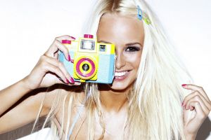 camera model rhian sugden painted nails women smiling