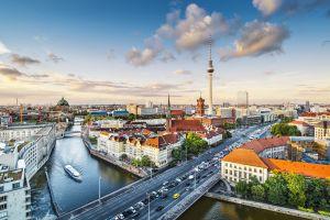 car building berlin bridge boat river cityscape