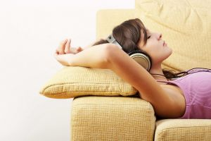 chill out brunette headphones profile pink tops closed eyes model women face