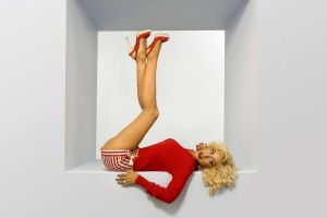 christina aguilera legs up singer blonde lying on back shorts red sweatshirt women pinup models