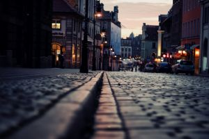 city street light dusk cobblestone street