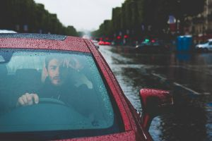 city street men red cars vehicle road car rain