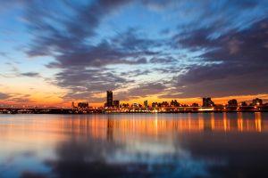 cityscape city sky clouds