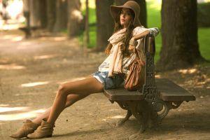 clara alonso model sitting women brunette bench women outdoors legs millinery
