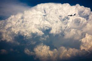 clouds aircraft sky