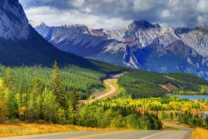 clouds road landscape trees mountains nature lake forest canada abraham lake