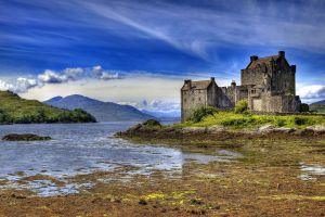 clouds scotland eilean donan mountains landscape water castle