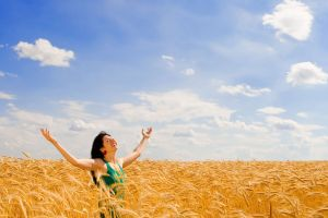 clouds sky arms up women field closed eyes women outdoors