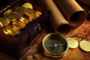 coins map compass gold