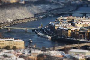 czech republic prague tilt shift river bridge blurred cityscape building