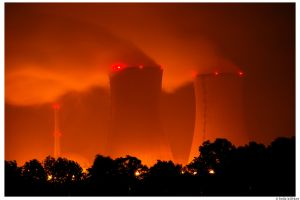 dark cooling towers night red