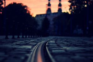depth of field lights trees building sunlight street tiles evening architecture sunset cityscape rail yard city