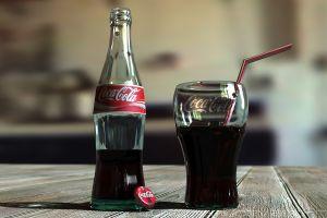 drink bottles coca-cola wooden surface