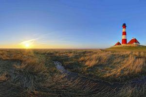 dune sunset sea lighthouse grass