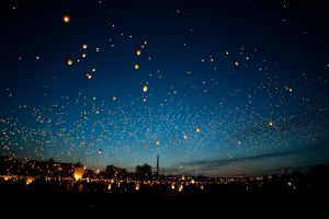 evening night glowing floating sky lanterns