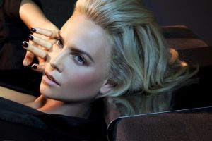 face charlize theron painted nails women green eyes jewelry black clothing blonde celebrity