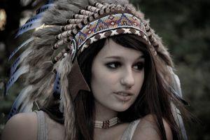 feathers piercing women headdress