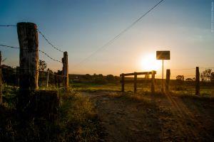 fence sunset sunlight signs landscape sun rays