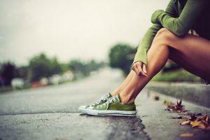 green sweater sneakers women legs tanned