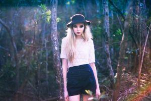 hat women model trees looking at viewer blonde
