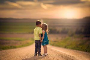 holding hands kissing children outdoors jake olson road