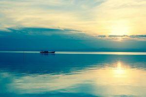 horizon blue calm waters water beach boat sea sky nature sunlight calm
