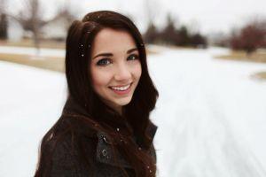 jacket looking at viewer women blue eyes snow redhead brunette depth of field snowflakes emily rudd black jackets smiling