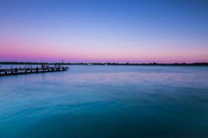 lake landscape platform purple sky sky ship