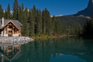 lake mountains house water landscape