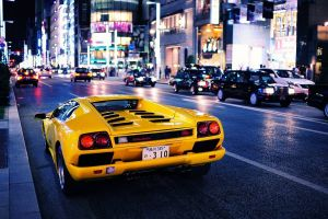 lamborghini lamborghini diablo yellow cars car city japan urban night vehicle traffic