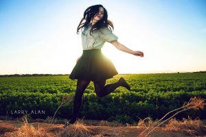 larry alan women outdoors women long hair brunette jumping sky sunlight