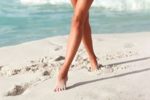 legs barefoot women sand covered sand