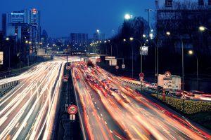 long exposure road light trails paris cityscape france street light