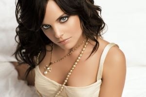 looking back simple background bare shoulders pearl necklace white tops looking at viewer white dress top view blue eyes necklace long hair women bed actress mena suvari