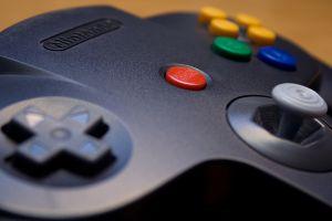 macro closeup retro games technology video games nostalgia nintendo 64 controllers nintendo buttons