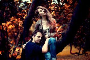 men fall bokeh trees closed eyes women women outdoors men outdoors couple hair in face outdoors