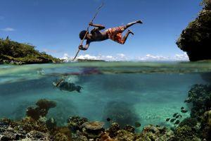 men fishing fish underwater