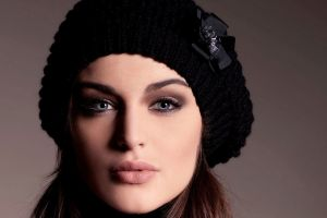 millinery brunette face women woolly hat simple background closeup looking at viewer blue eyes lauren budd
