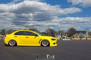 mitsubishi yellow cars car vehicle mitsubishi lancer evo x