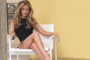 model black outfits bracelets women sitting chair tiffany mulheron