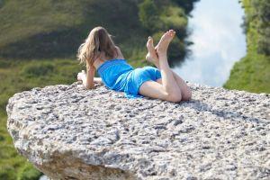 model cliff nature landscape lying on front feet long hair dress legs up blonde rock outdoors women outdoors women strapless dress
