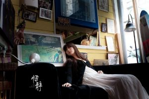 model looking away brunette sitting women asian