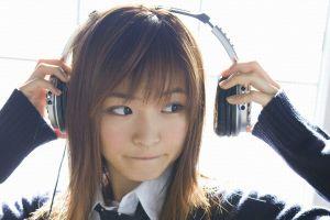 model looking away headphones women asian